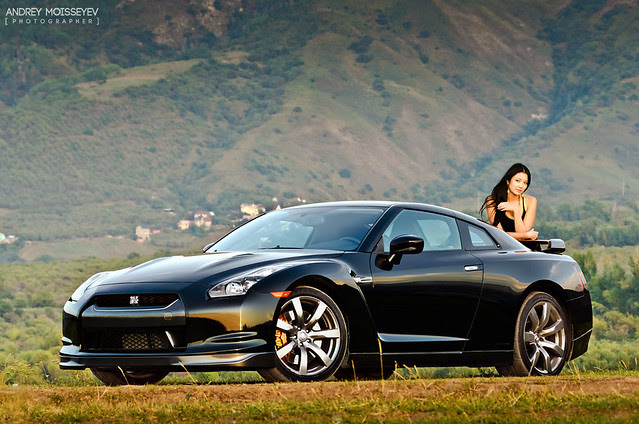 Black Nissan GTR and the girl