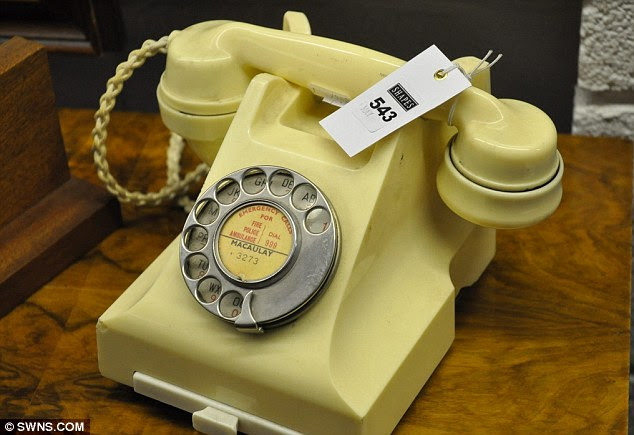 For sale: Scottish artist Jack Vettriano is selling the contents of his studio flat in Fife - which includes everyday items featured in his work. This phone is thought to be the same as was featured in The Arrangement