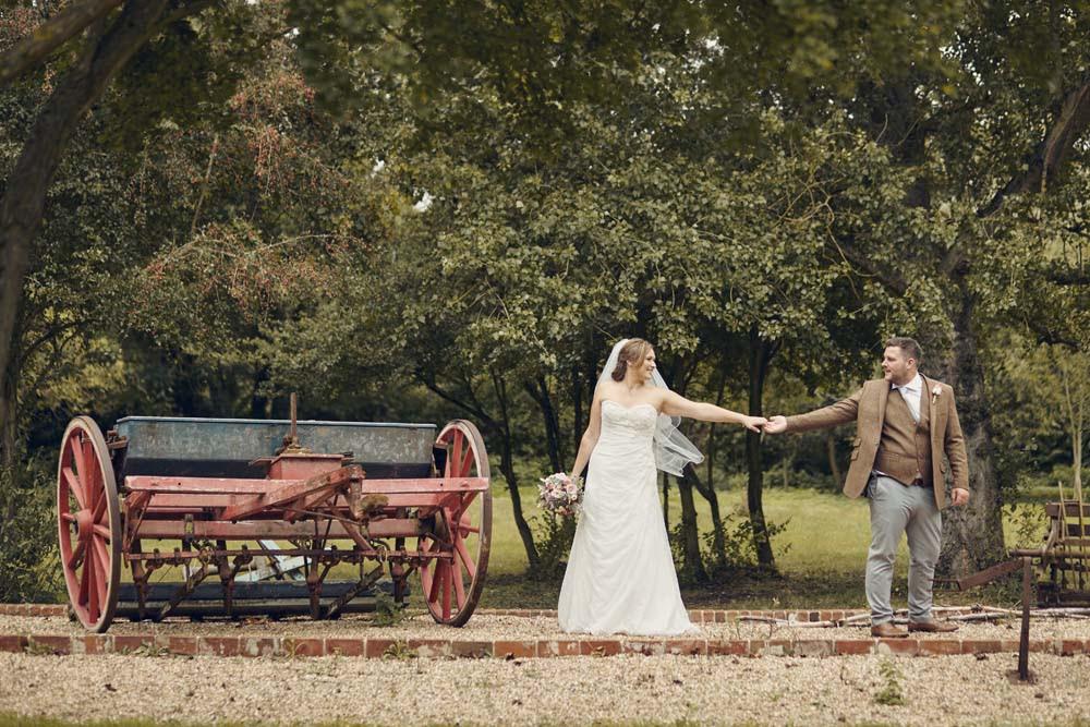 Vintage Farm Machinery with bride and groom, Tudor Barn, Belstead Wedding - www.helloromance.co.uk