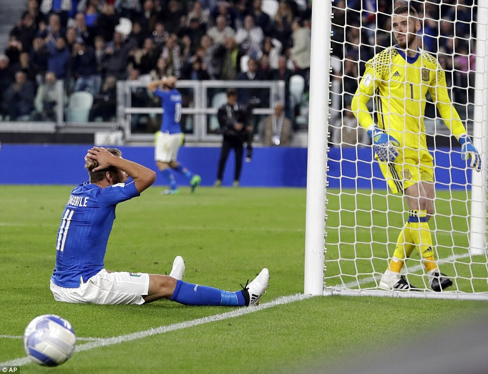 Italy substituteCiro Immobile (left) holds his head in his hands after missing a glaring chance to score an unlikely winner