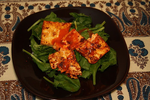 Tofu on bed of spinach