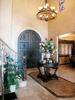 Large Wall Decor: Oversized Metal Wall Art in a Formal Foyer