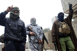 Gunmen fighters walk in the Gunmen fighters walk in the streets of the city of Falluja, 50 km (31 miles) west of Baghdad
