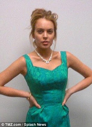 Finally back to the day job: Lindsay Lohan tries on Elizabeth Taylor-inspired outfits for new movie Liz And Dick