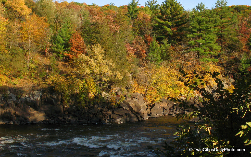 The fall colors are fading fast as the season changes into winter. I took this Autumn capture a couple of weeks ago in Taylors Falls. I would bet that the trees are looking very bare with very little leaves remaining on the branches.