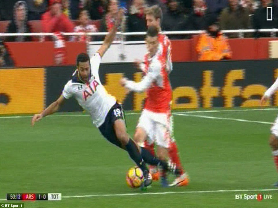 Dembele falls to the floor after Koscielny catches his foot rather than making clean contact with the ball