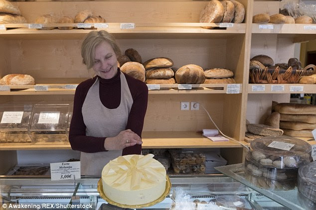 "A staff member at Julia bakery in Sevnica, Slovenia is pictured with a ""Melanija"" Cake ahead of the inauguration of Melania's husband Donald Trump"