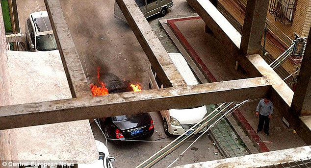Fire: The tank was ignited while the couple were in a car, driving away from their home in Guandong Province in South China