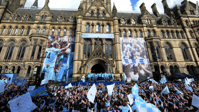 Fans gathered in their thousands in front of Manchester Town Hall as the City team emerged with the EPL trophy.