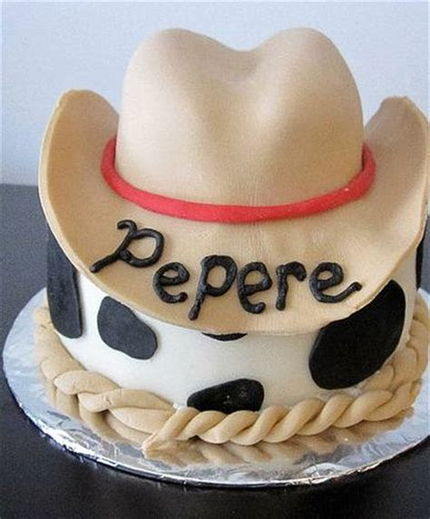 Cowboy hat cake with cow spots