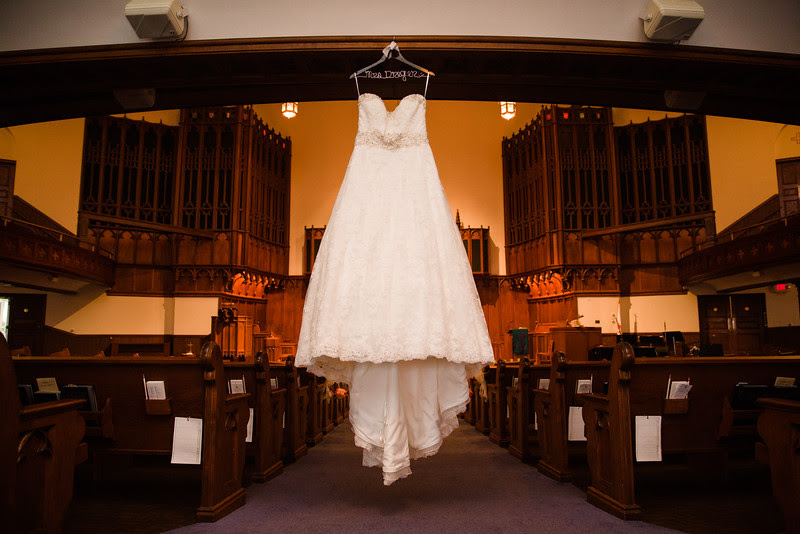 A dress hanging inside the sanctuary at Court Street United Methodist Church in downtown Rockford Illinois for an Autumn wedding.