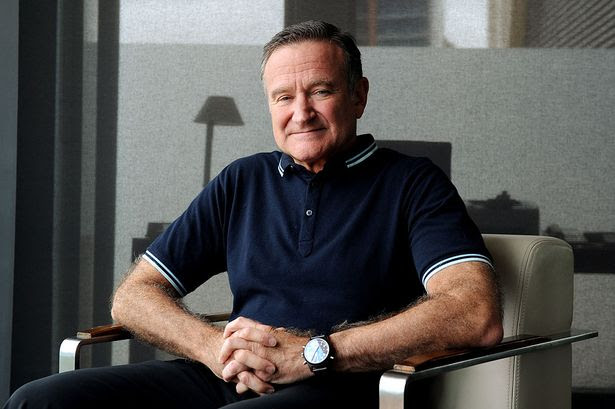 MAIN American actor/comedian Robin Williams poses for photographs in Sydney, Dec. 5, 2011