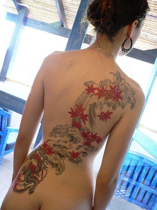 but hell what a beautiful tattoo, nice butt as well !