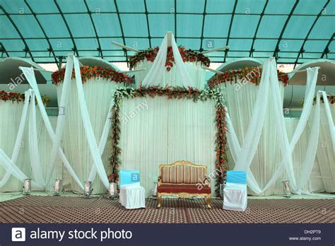 empty chairs sofa Indian Wedding reception hall decoration