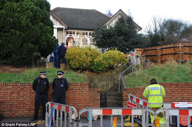 Inquiry: Police officers were pictured outside of the family home today as forensic search the premises