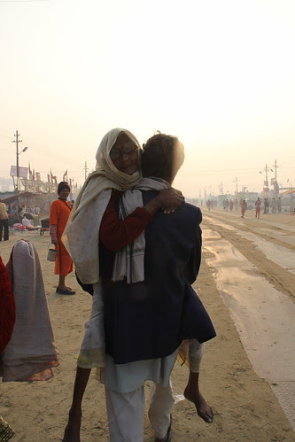 Son Carrying His Mother For The Holy Dip At Sangam by firoze shakir photographerno1