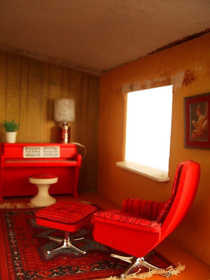 Vintage Lundby dolls' house study area with red piano, swivel chair and foot stool.