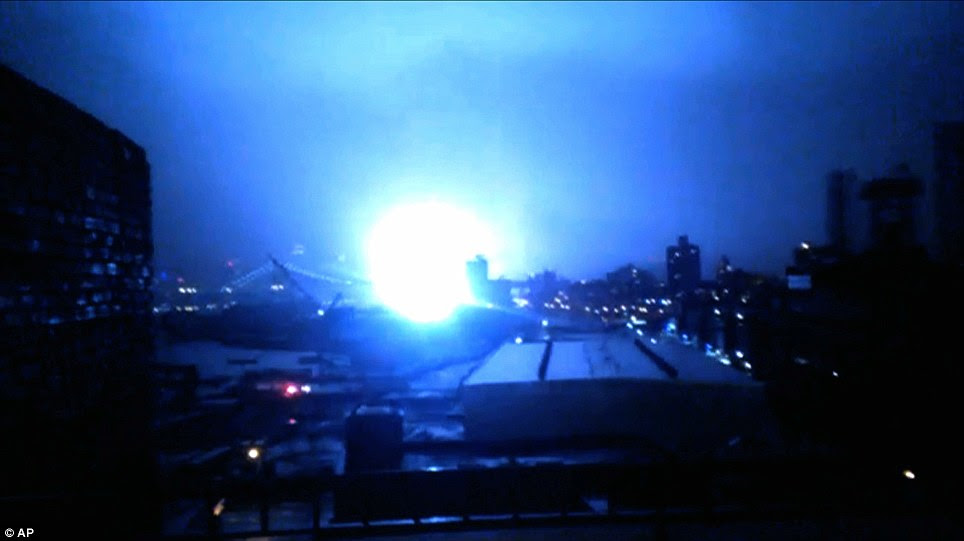 Bang: This image from video provided by Dani Hart shows what appears to be a transformer exploding in lower Manhattan as seen from a building rooftop in Brooklyn