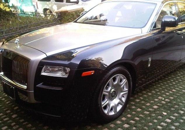 Behind the wheel: Kim drives her $250,000 black Rolls Royce Ghost