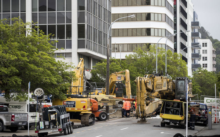 Construction vehicles at work on demolishing 61 Molesworth Street in central Wellington after it was damaged in the Kaikōura earthquake.
