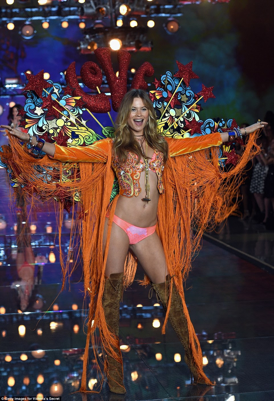 Love, love, love! Behati Prinsloo rocked a Summer Of Love vibe in her orange velvet fringed number