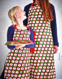 Aprons with apple print for children and adults
