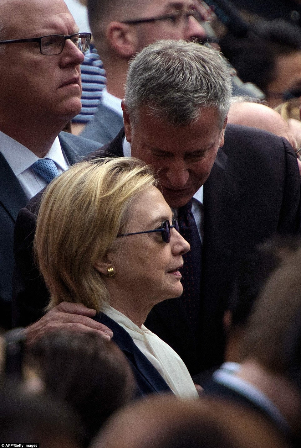 Hillary was joined by politicians, including Bill de Blasio, as mourners remembered the 15th anniversary of the attacks