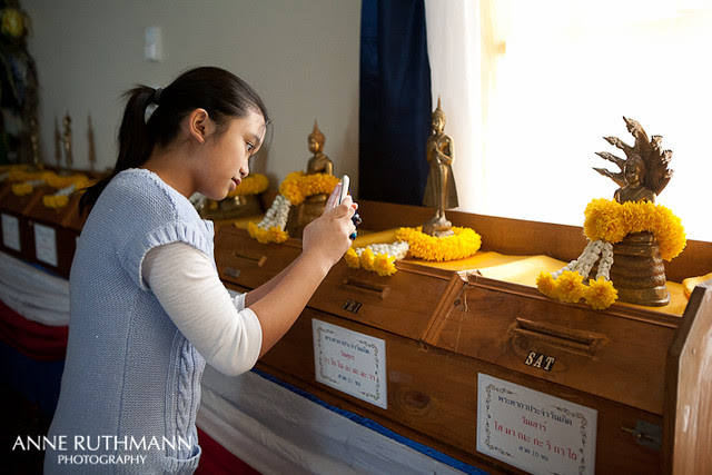 Hannah taking a picture of buddha statues