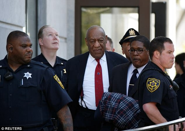 Cosby was flanked by police officers and his spokesman, Andrew Wyatt, after the guilty verdict was read