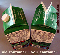 Photo: Milk containers, the old one with a twist-top spout, the new without. Copyright 2004 Mike Durrett, all rights reserved.