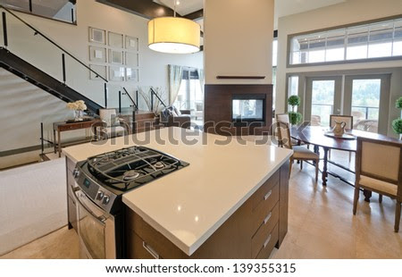 Luxury Modern Kitchen With The Living Room And The Fireplace At ...