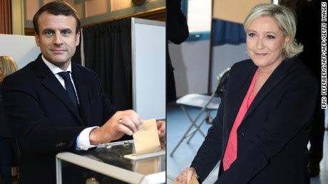 (COMBO) This combination of pictures created on May 07, 2017 shows French presidential election candidate for the En Marche ! movement Emmanuel Macron (L) casting his ballot at a polling station in Le Touquet, northern France, and French presidential election candidate for the far-right Front National (FN - National Front) party Marine Le Pen casting her ballot at a polling station in Henin-Beaumont, north-western France, on May 7, 2017, during the second round of the French presidential election.  / AFP PHOTO / Eric FEFERBERG AND joel SAGET        (Photo credit should read ERIC FEFERBERG,JOEL SAGET/AFP/Getty Images)