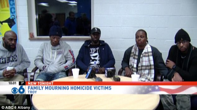 Pictured here are the family members including Isaiah (second from left) his AuntShakera Symes (second from right) and his UncleKhalif Coleman (center)
