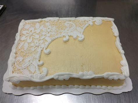 cake iced in buttercream and airbrushed gold. when dry