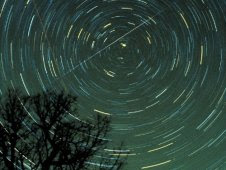 Star trails and a Geminid meteor over Brasstown Bald mountain, Georgia, in 1985.