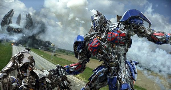 Optimus Prime confronts Galvatron as Lockdown's Knight Ship approaches in TRANSFORMERS: AGE OF EXTINCTION.
