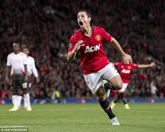 Roar: Javier Hernandez celebrates after handing Manchester United the lead at Old Trafford