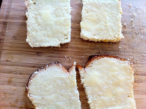 Slices of Bread Spread with Butter