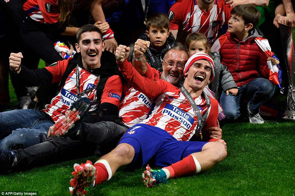 Griezmann celebrates with the families of his Atletico team-mates after his match-winning performance vs Marseille
