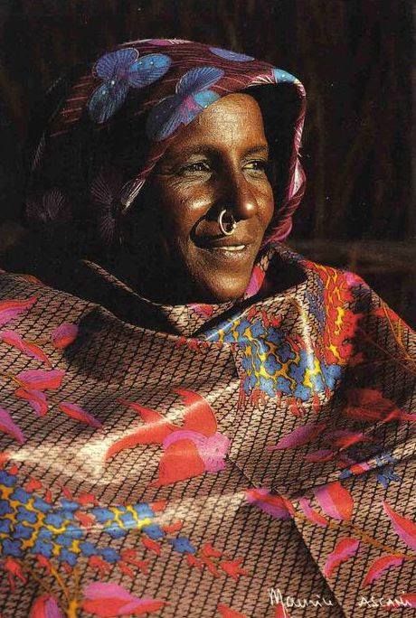 Africa | Toubou woman from Kaouar.  Niger | Scanned postcard; photo by Maurice Ascani, published by CFAO, Niamey, 1988