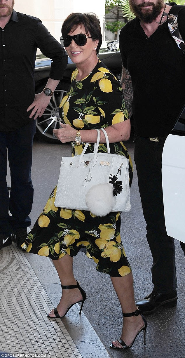 Tutti fruity!Adding another splash of colour to her ensemble, she carried a large white handbag in the crook of her arm which featured a large pom pom adorned with a giant K