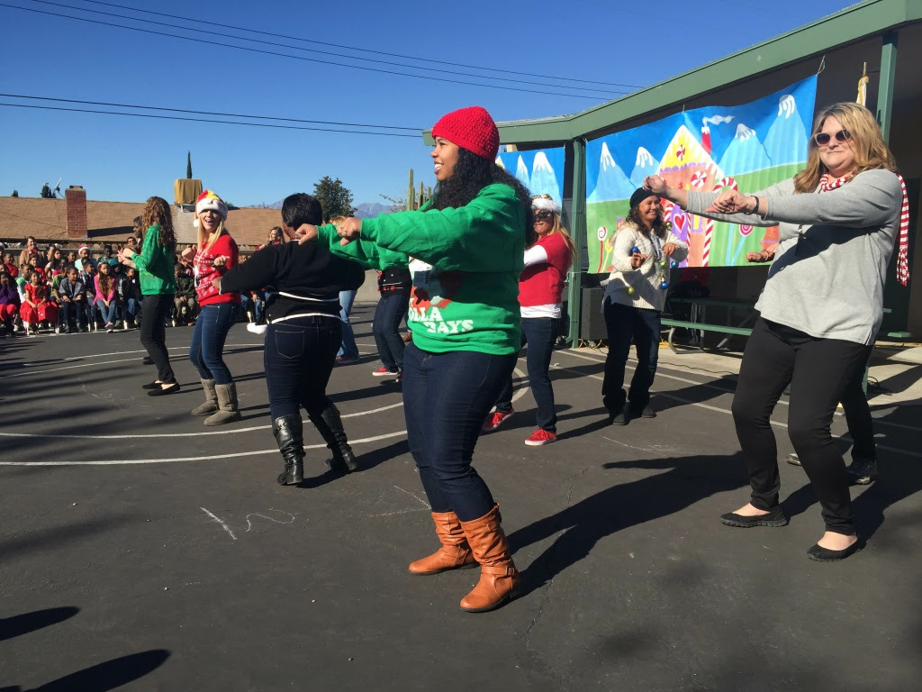 Teachers danced to a medley that included Christmas carols and pop songs.