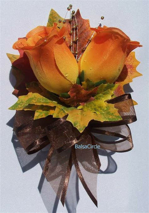 orange roses fall leaves pin  corsage autumn wedding