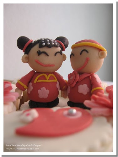Wedding Couple in Traditional Outfit Aliza Tan Tags wedding cupcakes
