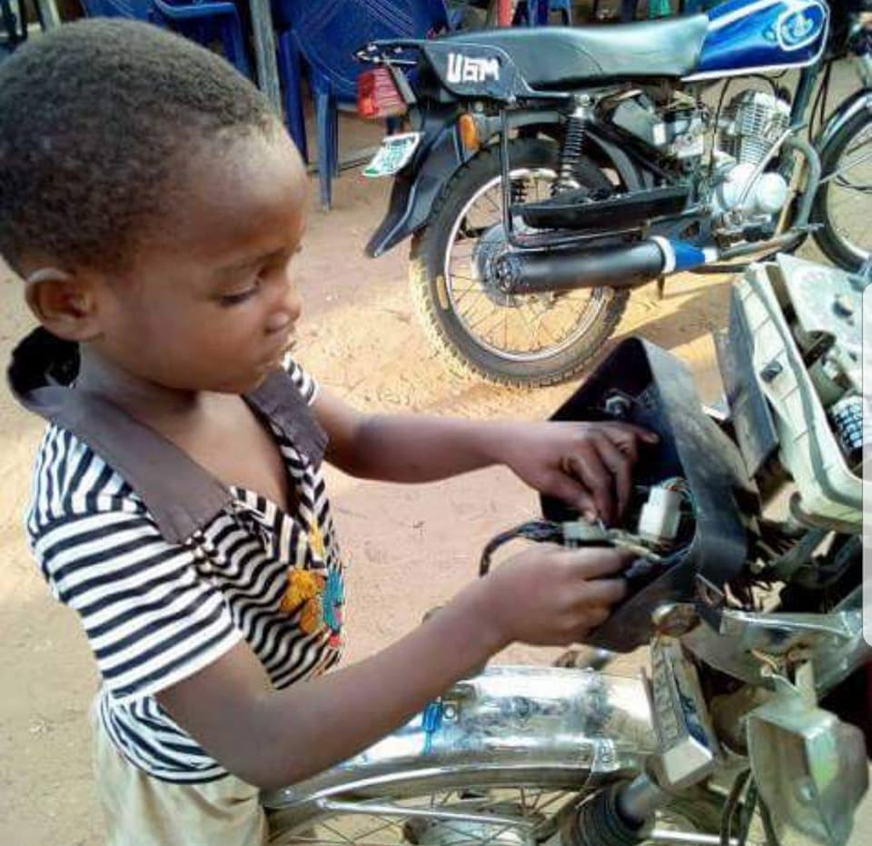 """See 5-Year-Old Boy Who """"Repairs Motorcycles"""" In Order To Raise School Fees (Pics)"""