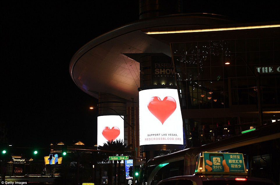 The Las Vegas strip pays tribute to the victims as appeals go out across the city for blood donors in the wake of the massacre at the Route 91 Harvest country music festival