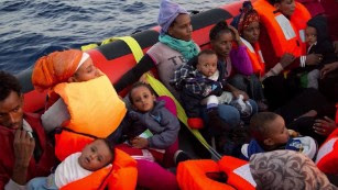 Migrant twins born at sea