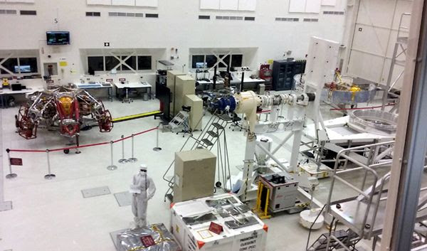 The Mars 2020 descent and cruise stages (the latter is visible towards the right edge of this photo) on display inside the Spacecraft Assembly Facility...at Explore JPL on June 9, 2018.