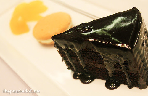 A Trio of Moist Chocolate Cake with Biscuit and Chilled Orange Compote