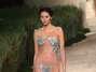 A designer de lingerie, que apresentou sua coleção em evento paralelo à semana de alta-costura de Paris, levou borboletas - e apenas borboletas cobrindo o corpo das modelos - à passarela Foto: Getty Images